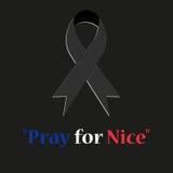 L'expression prient pour Nice écrit sur le fond noir Image libre de droits