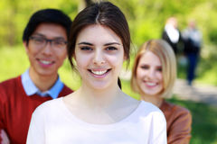 L group of students in park Royalty Free Stock Image