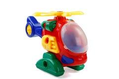 L'hélicoptère en plastique de l'enfant sur un blanc Photos stock