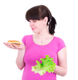 L'hamburger e l'insalata del wuth della giovane donna Fotografia Stock Libera da Diritti