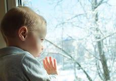 L'hiver derrière un hublot Photos libres de droits