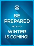 L'hiver est prochaine typographie avec la carte de Noël d'icône de flocon de neige Photographie stock libre de droits