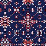 L'hiver sans couture a tricoté le modèle des flocons de neige rouges et blancs sur a Image libre de droits