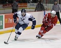 L'hockey portent le galet photographie stock