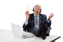 L'homme aîné Relaxed d'affaires a des idées Image stock