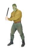 L'homme agressif menace par un bâton en caoutchouc Image stock