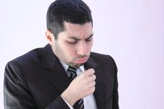 L'homme arabe d'affaires a la toux photos stock