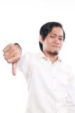 L'homme asiatique drôle montrant le pouce font des gestes vers le bas Images stock