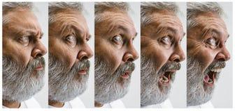 L'homme attirant supérieur semblant étonné d'isolement sur le blanc Image libre de droits
