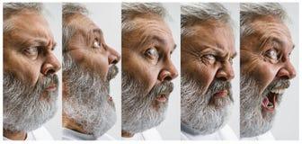 L'homme attirant supérieur semblant étonné d'isolement sur le blanc Images libres de droits