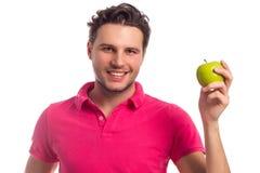 L'homme avec Apple a isolé sur le fond blanc Photo libre de droits