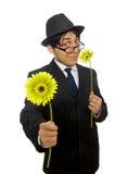 L'homme avec des fleurs d'isolement sur le blanc Images stock