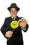 L'homme avec des fleurs d'isolement sur le blanc Image libre de droits