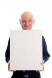 L'homme avec la tête chauve dedans indique une toile Photos libres de droits