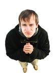 L'homme avec le visage de tristesse regarde dans un appareil-photo Image libre de droits
