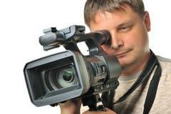 L'homme avec une caméra vidéo Image libre de droits