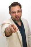 L'homme barbu appelle et fait des gestes avec son doigt photo libre de droits