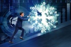 L'homme d'affaires éloignant des taux d'intérêt élevé Photographie stock libre de droits