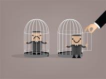 L'homme d'affaires a été libéré de la cage à oiseaux Images stock