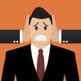 L'homme d'affaires était les oreilles couvertes par l'autre homme Image libre de droits