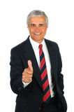 L'homme d'affaires aîné avec des pouces lèvent le geste Image libre de droits
