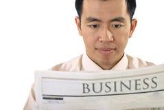 L'homme d'affaires a affiché le journal Image stock