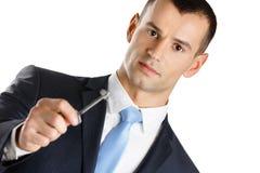 L'homme d'affaires affiche la clé Photographie stock