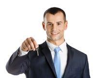 L'homme d'affaires affiche la clé Images stock