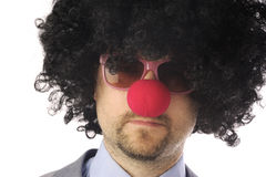 L'homme d'affaires aiment un clown Image stock