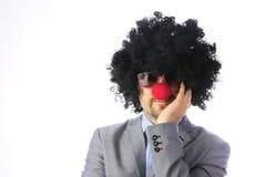 L'homme d'affaires aiment un clown Photos stock