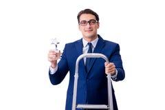 L'homme d'affaires au sommet de l'échelle avec le prix d'étoile Photographie stock