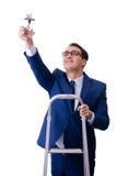 L'homme d'affaires au sommet de l'échelle avec le prix d'étoile Photo stock