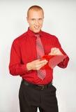 L'homme d'affaires avec écrit le document Photo stock