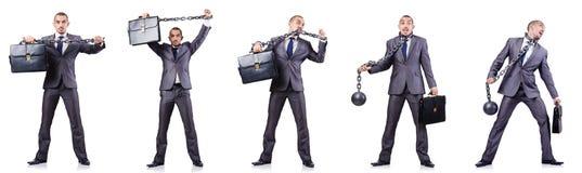 L'homme d'affaires avec des dispositifs d'accrochage sur le blanc Photographie stock