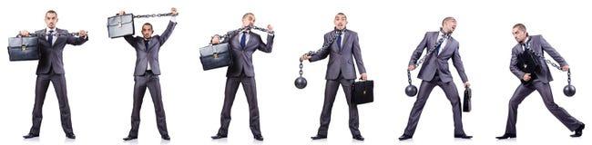 L'homme d'affaires avec des dispositifs d'accrochage sur le blanc Photo libre de droits