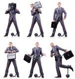 L'homme d'affaires avec des dispositifs d'accrochage sur le blanc Images libres de droits