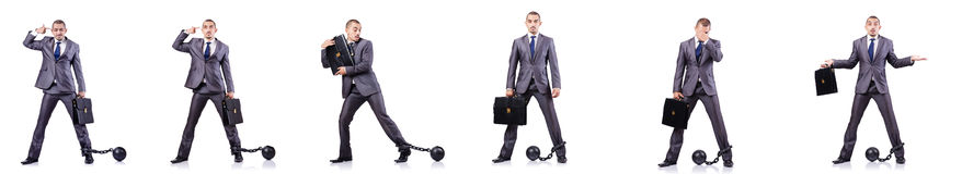 L'homme d'affaires avec des dispositifs d'accrochage sur le blanc Image libre de droits