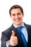 L'homme d'affaires avec des pouces lèvent le geste Photo libre de droits