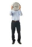 L'homme d'affaires avec l'horloge d'isolement sur un blanc Images libres de droits