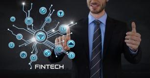 L'homme d'affaires avec la paume de mains ouverte et le Fintech avec de diverses icônes d'affaires connectent Photos libres de droits