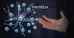 L'homme d'affaires avec la paume de mains ouverte et le Fintech avec de diverses icônes d'affaires connectent Photo stock