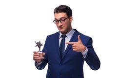 L'homme d'affaires avec la récompense d'étoile d'isolement sur le blanc Photo stock