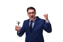 L'homme d'affaires avec la récompense d'étoile d'isolement sur le blanc Photos libres de droits