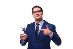 L'homme d'affaires avec la récompense d'étoile d'isolement sur le blanc Images stock