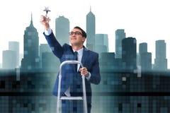 L'homme d'affaires avec la récompense d'étoile dans le concept d'affaires Photographie stock libre de droits