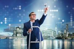 L'homme d'affaires avec la récompense d'étoile dans le concept d'affaires Photos stock