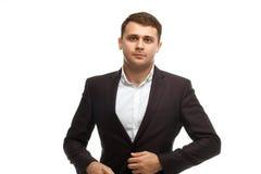 L'homme d'affaires bel ferment la fermeture éclair la veste Image stock