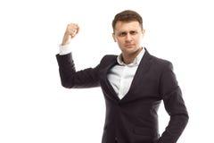 L'homme d'affaires bel montre le biceps Image stock
