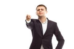 L'homme d'affaires bel montre le doigt en avant Photographie stock libre de droits