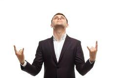 L'homme d'affaires bel montre le geste de roche Photos stock
